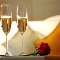 Champagne or wine can be placed at your beside.